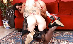 Inked lesbians in nylons and garters eat out each others pussy