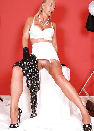 Buxom over 50 MILF Amazing Astrid undressing for nude photos