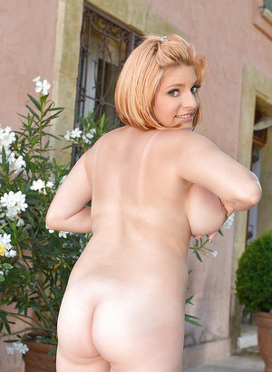 Chubby solo chick Lola Fauve unleashing big natural breasts outdoors
