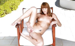 Redheaded European solo model Victoria Daniels showing of shaved pussy