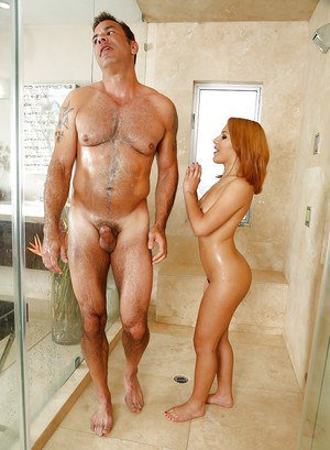 Petite redhead Liv Aguilera jerks off muscular stud in shower