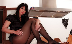Hot brunette nylon model Desyra Noir posing fully clothed before undressing
