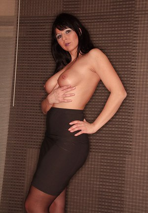 Topless Euro woman Desyra Noir posing in skirt and stockings