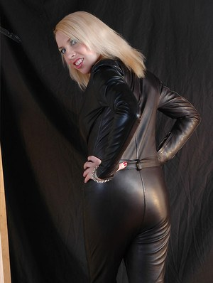 Blonde housewife with big natural tits changing into leather outfit