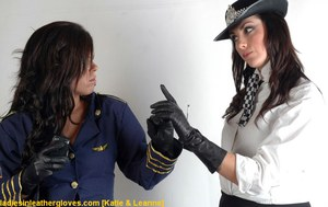 Hot brunette chicks in police and stewardess uniforms catfighting