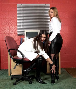 Hot chicks in otk black boots grab hold of each others bare ass