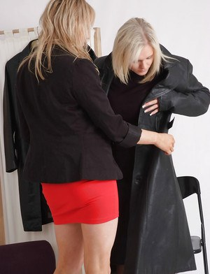 Non nude blonde females in high heels trying on leather jackets
