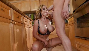 Chesty blonde MILF Eva Knotty using nice melons to tit fuck dick in kitchen