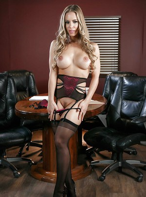 Blonde babe Nicole Aniston strips down to garters and nylons in office
