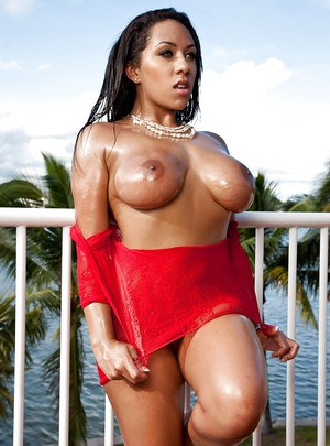 Busty European babe Priya Price showing off large natural breasts outdoors