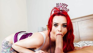 Redheaded cougar Jasmine James sucks off a monster sized cock