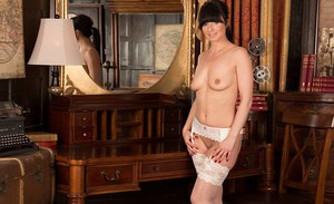 Brunette MILF Roxanne Cox pulling panties aside to bare shaved cunt