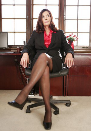 Older office worker Magdalene St Michaels undresses for nude photos