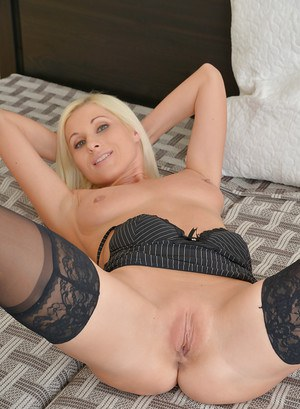 Hot euro blonde Vanessa Hell modeling on bed in sexy nylons and panties