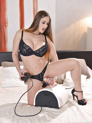 Busty mom Cathy Heaven riding the Sybian sex machine for anal stimulation