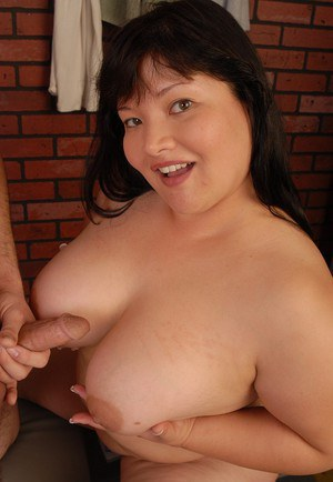 Asian plumper Olivia removers blouse to expose large natural boobs
