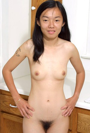 Young Oriental girl Tiffany revealing her tiny young girl breasts