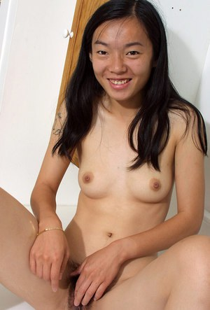 Young Asian model Tiffany and her tiny tits posing for topless photos