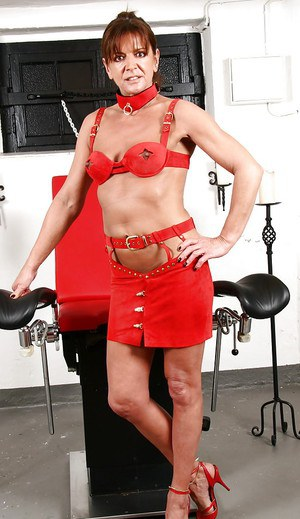 Mature redhead dominant Lady Sarah face sitting restrained man