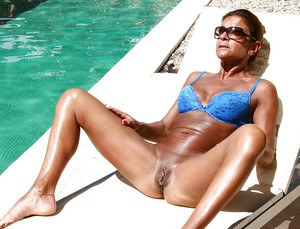Older Euro model Lady Sarah and pierced pussy pose outdoors in sunglasses