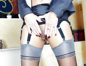 Mature British woman Lady Sarah modelling fully clothed in skirt and nylons