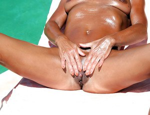 Older British gal Lady Sarah spreading shaved pussy outdoors