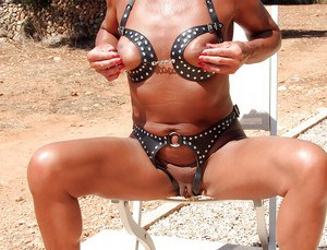 Blindfolded mature woman Lady Sarah playing with exposed nipples outdoors