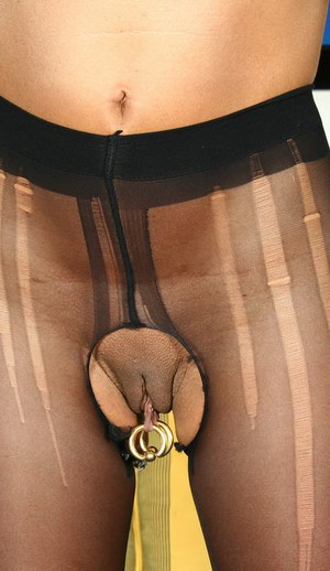 Mature dame Lady Sarah and pierced cunt model solo in crotchless pantyhose