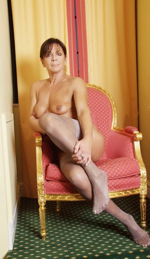 Older UK underwear model Lady Sarah showing off shaved mature pussy