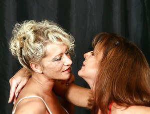 Mature UK woman Lady Sarah having lesbian sex with older blonde chick