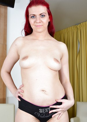 Chunky redhead Corazon Del Angel showing off her hairy vagina
