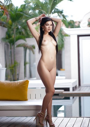 Exotic brunette babe Malena baring perfect ass beneath robe beside pool
