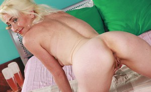 Skinny blonde lady Janotova undressing for masturbation of shaved vagina