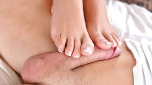 Leggy brunette beauty Shalina Devine using stocking clad feet to jack cock