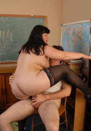 Brunette fatty Olivia tucking her student in classroom for grades