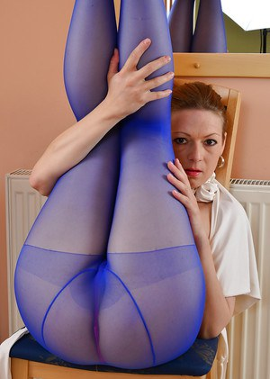 Tall mature woman Mischelle striking sexy solo poses in pantyhose