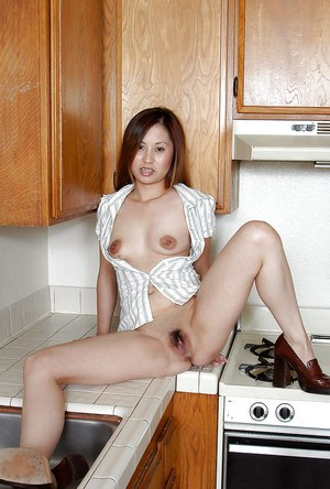 Cute Oriental first timer Cristina undressing for nude pictures
