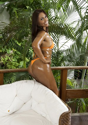 Oiled Brazilian beauty Cris Brasil letting tanned tits free from bikini