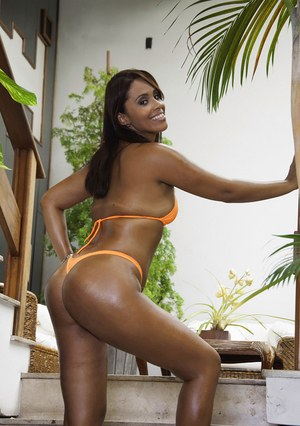 Exotic Brazilian bikini model Cris Brasil modelling outdoors