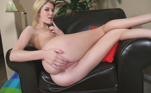 Young blonde chick Riley Ray undressing for nude photo session
