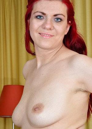 Mature redhead Corazon Del Angel unleashing experienced boobs