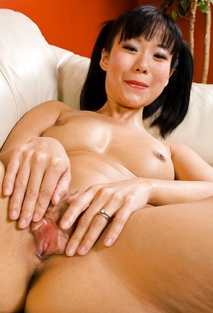 Oriental MILF Niya Yu exposing nice natural tits and masturbating