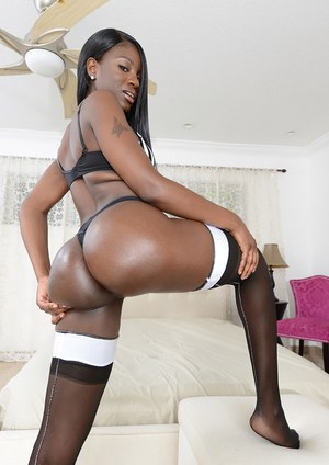 Ebony babe model Kay Love showing off phat black ass after removing thong