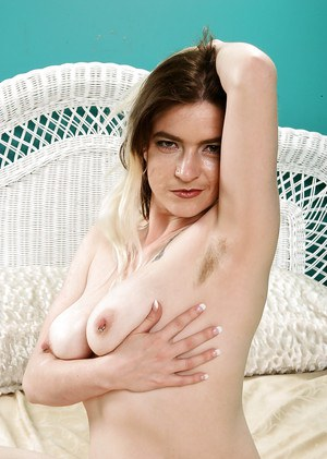 Aged solo model Tink showing off hairy underarms and bushy bush
