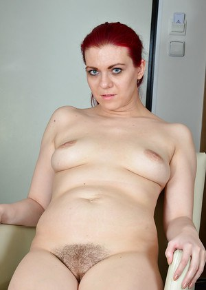 Redheaded mature woman Corazon Del Angel flashing leg underneath skirt