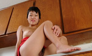 Asian amateur Vicky revealing hairy pussy and armpits in kitchen