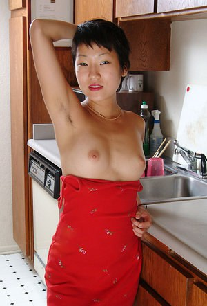 Petite Oriental first timer Vicky revealing nice perky tits and furry pits