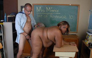 Chesty black schoolteacher Minxx revealing fat black boobs in classroom