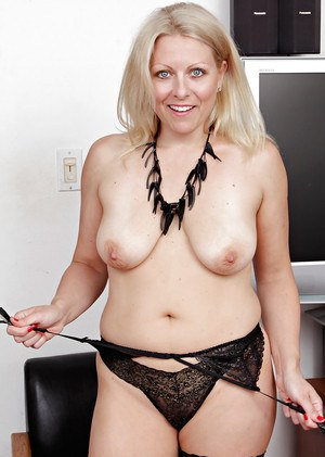 Older blonde mum Zoey Tyler undressing to spread shaved mature pussy