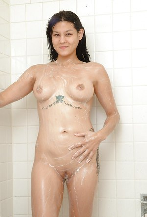 Sexy Asian amateur Whitney flaunting busty tattooed bod in shower stall